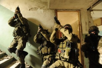 Polish special operations soldiers from the 1st Special Forces Regiment secure a stairwell during a culmination exercise in Trzebien, Poland, Aug. 4, 2010. The soldiers are participating in a partnership development program between Polish, Croatian and U.S. Army special operations units. (DoD photo by Staff Sgt. Isaac A. Graham, U.S. Army/Released)